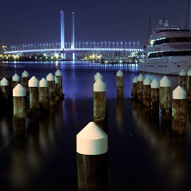 Moored by Ian McKellar - City,  Street & Park  Vistas ( water, calm, blue, moored, bridge, boat )