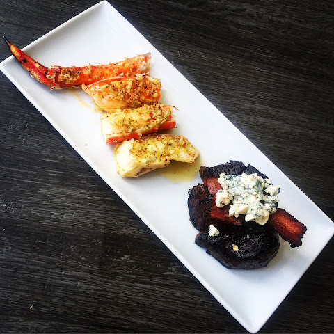 Broiled Alaskan King Crab In Garlic Parsley Butter + Pan Roasted Filet Mignon Topped With Belcampo Bacon & Maytag Blue Cheese