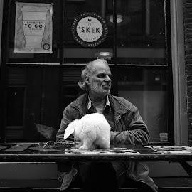 man with rabit  by Paul Batchelor - City,  Street & Park  Street Scenes ( monochrom, amsterdam, leica, street photography )