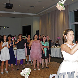 Throwing the Bouquet by Ingrid Anderson-Riley - Wedding Reception