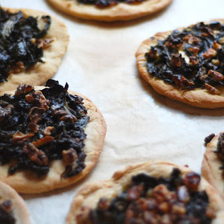 Spanish Coca With Wilted Green, Walnuts, and Raisins