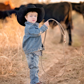 Roping by Carole Brown - Babies & Children Child Portraits ( black cowboy hat, blonde hair, 2 year old boy, blue eyes, roping cows )