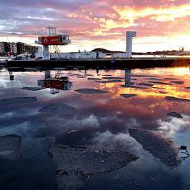 Sunset reflection by Kenneth Spaberg - Landscapes Sunsets & Sunrises ( reflection, container, sunset, ice, oslo, city, norway )