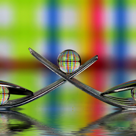 by Dipali S - Artistic Objects Other Objects ( abstract, reflection, color, colorful, still life, art, artistic, spoon, spheres, stripes, refraction )