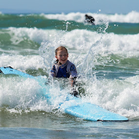 Kid Surfing on English Coast by Joe Proctor - Babies & Children Children Candids ( horseback riding, somerset, girl, surfing, great house, moor, waves, devon, weekend, sea, ocean, wetsuit )