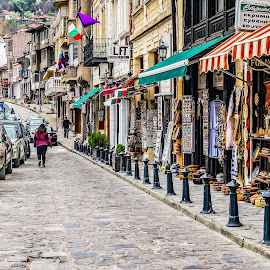 Pedestrian street with souvenir shops by Opreanu Roberto Sorin - City,  Street & Park  Markets & Shops ( shop, famous, old, europe, store, street, house, architecture, travel, people, historic, city, ancient, turnovo, flowers, classic, bulgaria, building, vintage, veliko, tourism, cart, ox, landmark, tourist, european, background, town, local, bulgarian, medieval, tarnovo, walk, balkans )