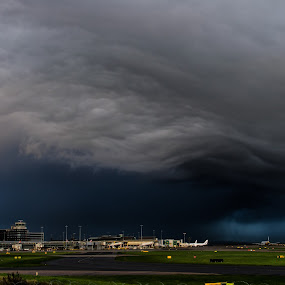 Bizarre Weather Front at the Airport by Michael Ripley - Landscapes Cloud Formations ( clouds, airport, weather, storm, planes )