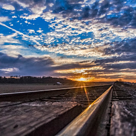 Rail to the Sun by David Patterson - Landscapes Sunsets & Sunrises ( field, farm, reflection, blue sky, barn, rails, sunset )
