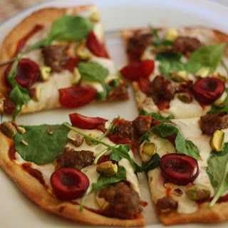 Low-Carb Cracker Crust Pizza with Sausage, Cherries, and Arugula