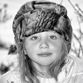 Ice Baby by Sandy Considine - Babies & Children Child Portraits ( winter, black and white, winter hat, young girl )