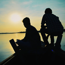 Journey! Silhouette by Nishchay Kashyap - Instagram & Mobile Android ( water, assam, sunset, journey, silhoutte, people, black )