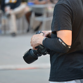 Ready to Shoot by Thomas Shaw - People Portraits of Men ( camera, photographer, oak city 7, tee shirt, arm, gray, photography, black, man, oc7, shooting )