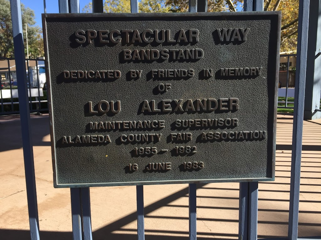 SPECTACULAR WAY BANDSTAND DEDICATED  BY FRIENDS IN MEMORY OF LOU ALEXANDER MAINTENANCE SUPERVISOR ALAMEDA COUNTY FAIR ASSOCIATION 1955 - 1982  16 JUNE 1983 Submitted by Sheila Paske