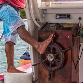 At the Helm  by Samy St Clair - Transportation Boats ( water, brazil, paraty, vacation, wheel, rio de janeiro, steering, feet, candid, helm, transportation, boat, brasil, relax, tranquil, relaxing, tranquility )