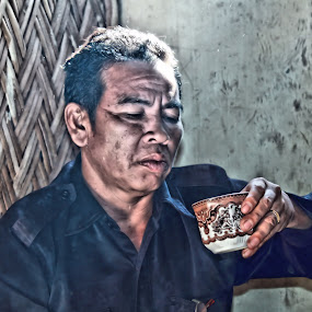 man with a cup of coffe by Gionk Gafur - People Portraits of Men ( potrait, nature, color, lanscape, forest )
