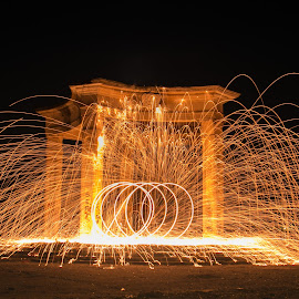 Playing with fire by Natalia Dobrescu - Abstract Fire & Fireworks ( park, colors, romania, yellow, architecture, fire, photography, city, bucharest, steel wool, night, long exposure, historical, sparks, light )