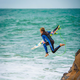 Rock jump by Catherine Thuaux - Sports & Fitness Surfing ( swell, surfing, surf board, australia, beach, surf, avoca beach )