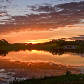 Lake on Fire by Robert Coffey - Landscapes Sunsets & Sunrises ( water, clouds, sunset, reflections, lake,  )