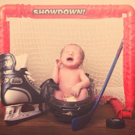 A hockey star is born by Joseph Humphries - Babies & Children Babies ( inccocence, skate, hockey, funny, hockeystick, crying, baby, helmet, puck, newborn )