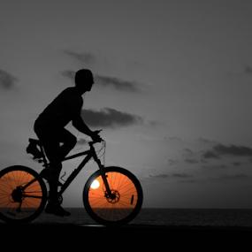 Riding at sunset by Yuval Shlomo - Sports & Fitness Cycling (  )