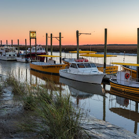 Shrimp boat sunset by Jason Lemley - Transportation Boats ( shrimp boats, sunset, pier, rocks, tybee island )