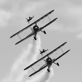 Wingwalkers on the Nose by DJ Cockburn - Transportation Airplanes ( monochrome, black and white, shuttleworth collection, flying, england, airfield, formation, edwardian pagent, boeing kaydet, propeller, vintage, acrobatics, aeroplane, airplane, aerodrome, display team, biggleswade, smoke, breitling wingwalkers, grayscale, flight, boeing-stearman model 75, biplane, old warden, aircraft, air display, bedfordshire, historical, antique, athletic, air show )