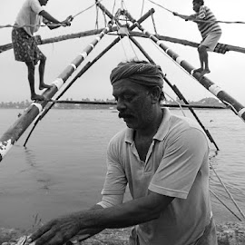 catch of the day by Prabhat Kumar - People Portraits of Men ( black and white, profession, india, fisherman, people )
