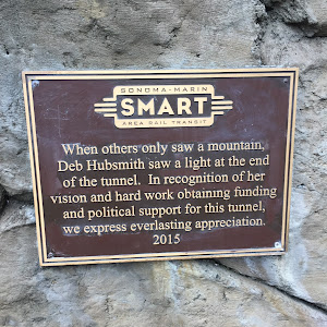 SONOMA-MARIN SMART AREA RAIL TRANSIT When others only saw a mountain, Deb Hubsmith saw a light at the end of the tunnel. In recognition of her vision and hard work obtaining funding and political ...