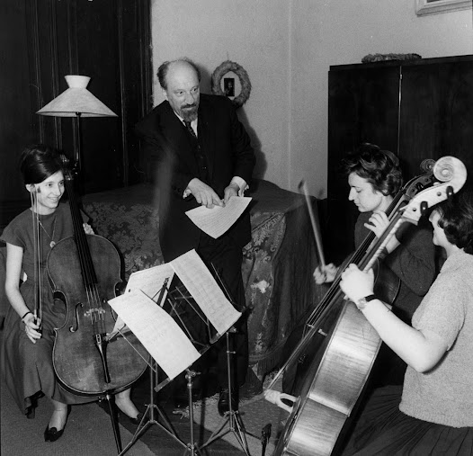Matz teaches three young women who are apparently practicing chamber music.  This took place around 1963.