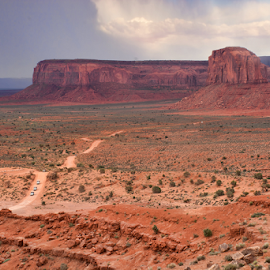 Monument Valley #1 by Phyllis Plotkin - Landscapes Caves & Formations ( clouds, scrub, monument valley, rock formations, plains )