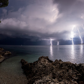 Amazing night by Matic Cankar - Landscapes Weather ( thunder, clouds, lightning, village, autumn, beautiful, sea, night, storm, rocks, coast )
