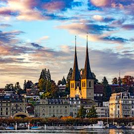 Dramatic Lucerne, Switzerland by Amit Aggarwal - Landscapes Sunsets & Sunrises ( boat ride, sunset, boats, switzerland, lake, dramatic sky, lucerne )