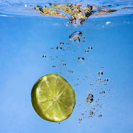 A Drop of Lime  by Paul Putman - Food & Drink Fruits & Vegetables ( colour, water, flash, fruit, splash, lime )