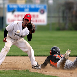 Sliding into second by Keith Johnston - Sports & Fitness Baseball ( infield, ball, sliding, second, baseball, dust, sport, glove, game, dirt, competition,  )