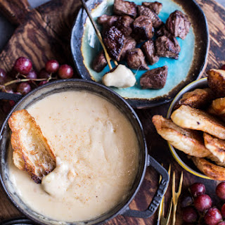 Smoky 3 Cheese Fondue with Toasted Garlic Buttered Croissants.