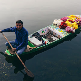 Flowers Seller by Husaini Pangeran - People Portraits of Men ( srinagar, dal lake, oly, kashmir, india, dallake, flowers, seller, man, olympus )
