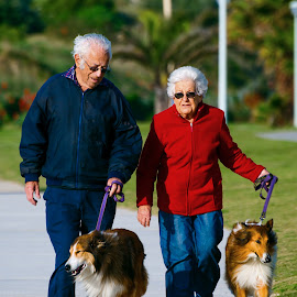 I walk beside you by Rulie Arifin - People Couples ( walking, old man, elderly, old woman, dog, people, couples )