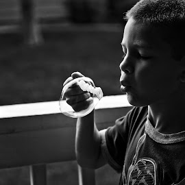 Bubbles!  by Allie Cook - Babies & Children Children Candids ( bubble, black and white, bubbles, blow bubbles, childhood )