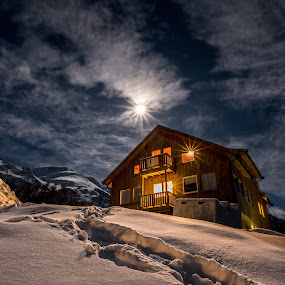 Warmth in the cold by Nikolas Alsterlund - Buildings & Architecture Homes ( clouds, moon, mountain, warm, scandinavia, house, landscape, troms, norway, mountains, cold, blue, snow, path, night, gold, arctic, nikon )