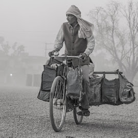 On they way of life by Bishal Ranamagar - Transportation Bicycles ( life, nepalgunj, black and white, documentary, nepal, bicycle )