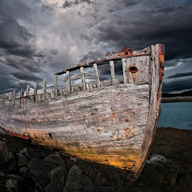 Shore of Boulders  by Þorsteinn H. Ingibergsson - Transportation Boats ( clouds, iceland, sky, nature, wreck, structor, boat, landscape, abandoned )