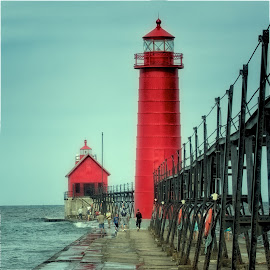 Walking the Pier at Grand Haven Lighthouse by Betty Arnold - Buildings & Architecture Other Exteriors ( lighthouses, seascapes, lake michigan lighthouses, great lakes lighthouses, grand haven lighthouse )