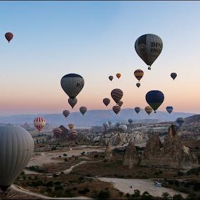 Sunset over Cappadocie by Bram de Mooij - Travel Locations Air Travel ( cappadocie, sunset, balloons )