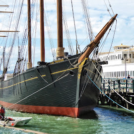 An old-time windjammer sailing ship by Sandy Scott - Transportation Boats ( water, ship, fisherman's wharf, travel, windjammer, landmarks, sailing, worker, ships, lines, antique ship, antique, repairs, san francisco, masts, sailing ship )