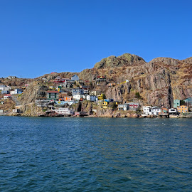 Living On The Edge by Harold Bradley - Buildings & Architecture Homes ( clear, on the water, sky.blue, houses, battery town, cloudless, cliffside, ship, homes, boat )