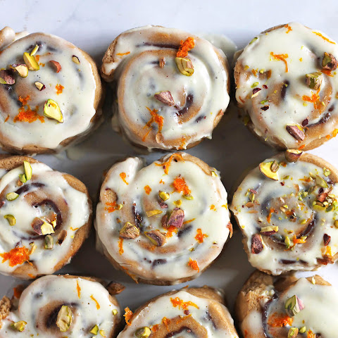 Whole Wheat Chocolate Cinnamon Rolls with Pistachios + Orange Icing (vegan!)