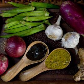 by Aparajita Paul - Food & Drink Fruits & Vegetables ( mustard paste, onions, greens, vegetables, eggplant )
