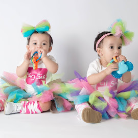 Two Cute by William McCraney - Babies & Children Toddlers ( babies, sisters, toys, adorable, little sister big sister, siblings, cute, pretty, twins )