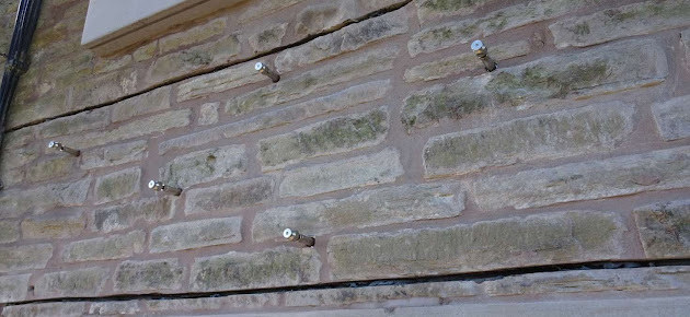 Structural brick stitching and grouting