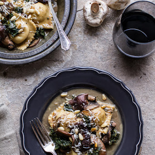 Taleggio Ravioli with Garlicy Butter Kale and Wild Mushroom Sauce + Toasted Pine Nuts.